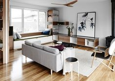 Contemporary living room with built in storage and bench seating