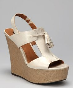 Take a look at this Off-White Brynne T-Strap Slingback Wedge by Calvin Klein on #zulily today! $59.99, regular 109.00PRODUCT DESCRIPTION: A classic T-strap silhouette with a comfy elastic slingback crafted out of rich burnished leather sits atop a chunky fabric-covered wedge for a wow-worthy look packed with polished style.   5'' heel with 1.75'' platform Leather upper Man-made sole Imported