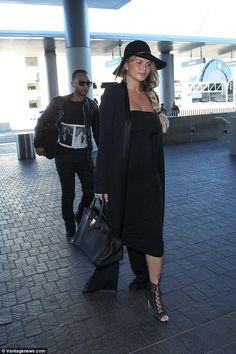 Chrissy Teigen wearing Hermes Birkin Bag and Lanvin Chain-Embellished Rabbit and Hare-Felt Hat