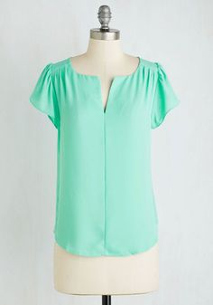 You measure success in caring connections, and as you host a soiree in this bright mint blouse, you excitedly watch friend groups interact! Featuring a notched neckline, pleated shoulders, and fluttery sleeves, this lightweight top earns you style status while your gathering grows your heart.