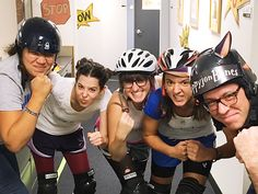 Dial Books for Young Readers and Kathy Dawson Books staffers took a spin as a roller derby team, inspired by Victoria Jamieson's Roller Girl : (from l.) Jasmin Rubero as Katniss EverMean, Stacey Friedberg as Lemony Whip-It, Ellen Cormier as Anne of Mean Gables, Claire Evans as Malice in Wonderland, and Jason Henry as Skippyjon Bones.