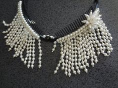 Hey, I found this really awesome Etsy listing at https://www.etsy.com/listing/156442996/pearl-silver-beaded-hair-clip-comb