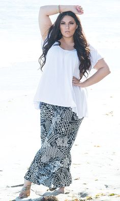 "Basic Babe in plus size -  Our ""basic"" print is one to notice. These pants will carry you through lazy summer afternoons and sexy evening strolls."