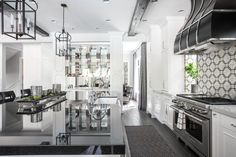 Polished Nickel cabinets framed by two columns give this kitchen a nice edge