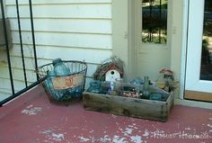 I love the idea of the blue mason jars in an old wire basket. This would look cool on our rustic bench on the porch.