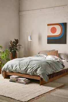 Bedroom with blue bedding and wooden bed