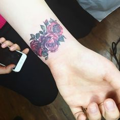 Roses on Wrist by Mojo