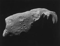 a close up of a mountain: View of asteroid 243 Ida, mosaic of 5 image frames aquired by Galileo spacecraft's Solid State Imaging System.