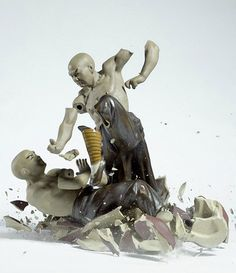 Porcelain fighting figures dropped and photographed the moment of shattering.