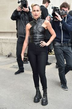 Rockstar chic: Model stunner Alice Dellal opted for a seriously racy and almost rockstar look as she posed outside the venue in a figure-hugging black leather top and skintight trousers, teamed with chunky boots