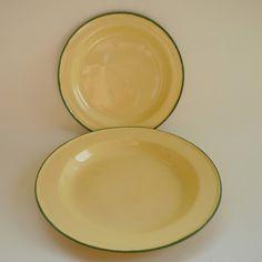 Vintage creamy yellow enamel plates with green trim