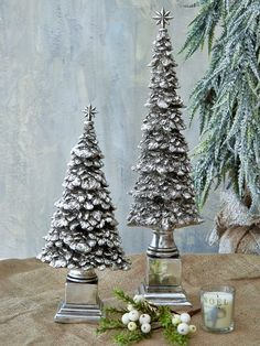 Traditional Christmas preparations wouldn't be complete without a tree. These polyresin aged silver ones, each sitting on a silver plinth and topped with a star, play the part to perfection.