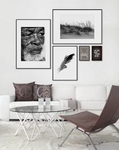 Framed art above a white sofa, gallery of art. Brown leather chair. www.desenio.se