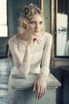 ROSALIND Bold textured dimensional lace column with featured raised neckline. http://www.michelleroth.com/bridal-gowns/rosalind/