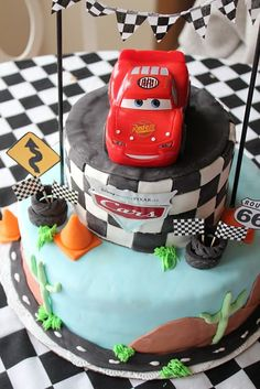 Cars...most likely Waylons 3rd bday cake lol