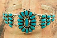 Beautiful Petit Point Design with Genuine Morenci Turquoise set in Sterling Silver Bracelet. Created by Zuni Artist Lorraine Waatsa. Signed by the artist. Morenci Turquoise is one of the first American Turquoises to come to the market, Morenci is highly valued and difficult to obtain. The Morenci mine is in southeastern Arizona and is now closed and buried under tons of rock. Morenci Turquoise is now obtained from private collections. The Zuni Pueblo is located in New Mexico, Land of…