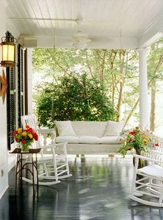 Great front porch, complete with swing and rocking chairs.