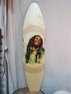 "Artist: Taylor F.  ""a longboard I carved. Bob Marley is painted in Acrylic, and the design around is woodburned and woodstained."""