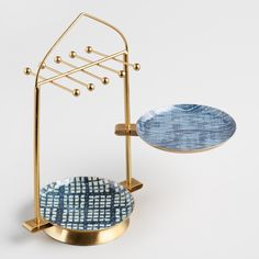 Our two-tiered jewelry stand is crafted with mesmerizing indigo blue geometric patterns on its two swivel dishes and a glistening gold frame. Jewellery Storage, Jewelry Organization, Jewellery Display, Headband Display, Earring Display, Jewelry Store Displays, Jewelry Stores, Jewelry Stand, Jewelry Holder