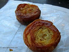 {Day 10} Kouignettes from George Larnicol. They are sweet little pastries filled with lots of butter and sugar, and are a specialty from Brittany, France.  #30daysinParis http://whyroamtravel.com