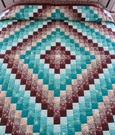 Trip Around the World Quilt * King size, hand stitched quilt, 108 x 108. * The classic Trip Around the World pattern in aqua and brown is accented with a double border of solid brown and brown floral fabrics. * The trip around the world quilt pattern is a classic patchwork pattern