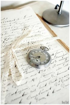 Old French documents and a pocket watch
