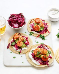 "Shrimp ""Ceviche"" Tostadas are made by mixing cooked shrimp with a lime dressing and can be served on tostada shells or as a dip with chips on the side Mini Pizzas, Pain Pita, Mexican Food Recipes, Healthy Recipes, Mexican Dinners, Pickled Cabbage, Shrimp Ceviche, Turkey Enchiladas, How To Cook Shrimp"
