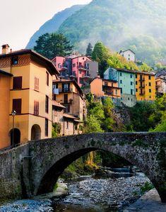 Fog drifts down a mountain and through an idyllic village along Lake Como, Italy