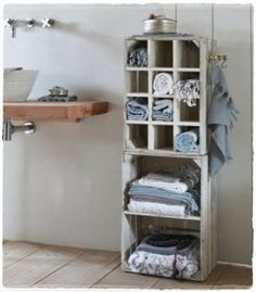 Whitewash crates for bathroom storage