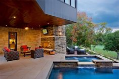 outdoor fireplace, covered seating, and pool