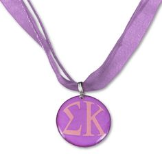 Show off your sorority letters and colors with our Sigma Kappa Ribbon Necklace. The lavender color really stands out. A beautiful gift for your Big Sis or Lil Sis! A Greek Licensed Product. Sorority d