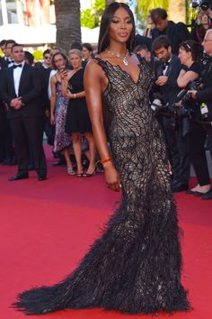 #NaomiCampbell wearing a black and nude crystal embellished #AtelierVersace evening gown with feather train at the 70th Anniversary of the annual #CannesFilmFestival.