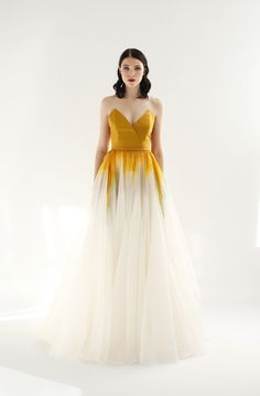 From the Fall 2018 Collection - Ivory and Autumn Gold & Haze gradient printed gown with strapless overlap V-neck bodice in rich silk twill. Thin silk belt at waist. Full A-line skirt in silk organza with additional flounces for volume. Closes with zipper up the back.  . It closes with a zipper