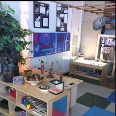 Great space created by mirrors, lighting, plants, and neutral colours. # Reggio
