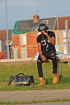 Bucket Hat, Long Clothing T Shirt, Topman Ripped Jeans, Timberland Boots, Asos Adidas Holdall Bag, Gold Casio Watch, Gold Chain