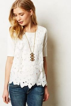 Like outfit, especially the top, but would like a less trendy looking necklace to pair with.