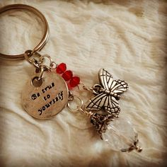 Check out this item in my Etsy shop https://www.etsy.com/listing/459744648/handmade-red-silver-keychain-be-true-to