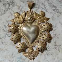 Gold metal heart pendant - surrounded by gold cherubs