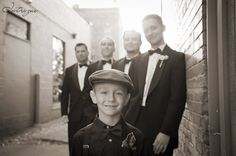 How awesome is this Jr Groomsmen in the front?!  He's stylin'! Photography by: Intrigue Studio  www.Intrigue-Photography.com