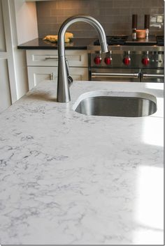 Think this is cararra marble? Think again! It's silestone quartz!  Lots easier to maintain than marble