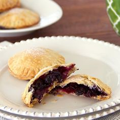 The hand held mini pie is filled with a cardamom-spiced blueberry filling. Use refrigerated pie crusts for quick and easy preparation.