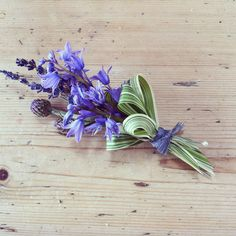 Campbell's Flowers: Bluebells, cornflower, lilac and grasses finished with a grey raffia bow