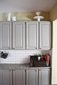 painted cabinets (Bedford gray by martha stewart); white subway tiles with dark gray grout