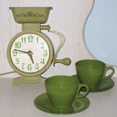 Vintage kitchen clock that still runs along w/ matching green cups & saucers for your rustic or retro kitchen. Available at my shop.     This is beautiful