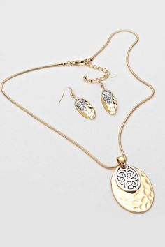 Hammered Gold and Silver Filigree Discs layered in timeless classic. Matching Earrings Included.