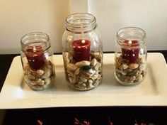 Rocks and candles in mason jars.