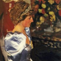 1986: Princess Diana in a blue shiny gown (though looks grey here), tiara..Spain. Guests of King Juan Carlos and Queen Sofia. I think this is the shiny blue gown Diana wore in Tokyo 1986, without a tiara but with a necklace, and similar drop pearl earrings..