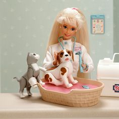 Vet Barbie - I had this. The pet bed actually made a cat and dog sound, depending on which button you pushed