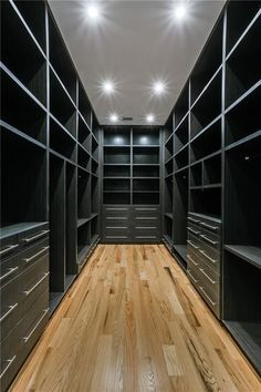 Contemporary Closet with Built-in bookshelf, Hardwood floors, High ceiling Micoley's picks for #Flooring www.Micoley.com