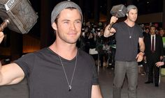Chris Hemsworth holds up the hammer of Thor at Tokyo airport #DailyMail
